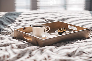 Realign Design offers design services for any room - breakfast tray on bed