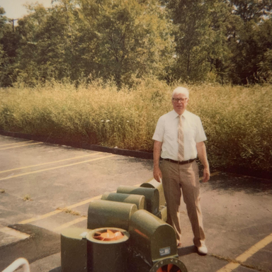 Allen McCoy showing off an HVAC product in the early years of the company