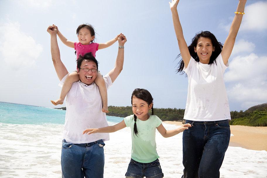 asian-family-on-beach.jpg