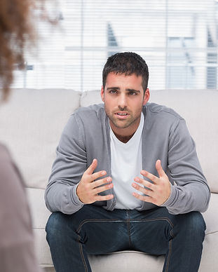 Man telling therapist his problems sitti