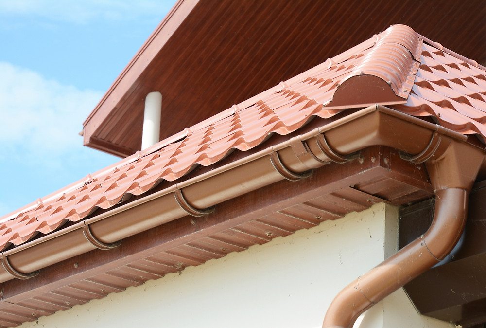 gutter on home during soft washing - dykes pressure cleaning
