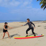 Learn to surf in Vanuatu, Surf Retreats, Surf Holiday. Women surfing