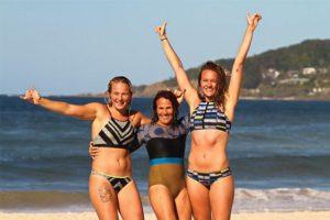 women surfing happy friends surfwear surf bikini onepiece fashion byron bay