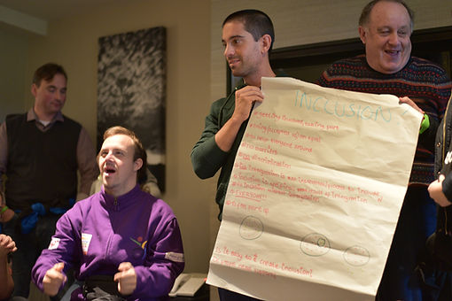 A group giving a presentation on inclussion