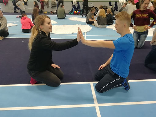 A pair high five during a Beat it activity