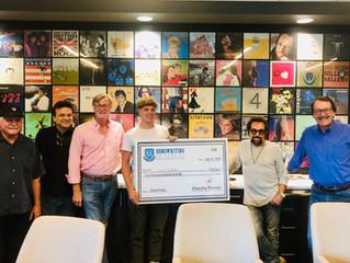 $10,000 SONGWRITING COMPETITION WINNER SURPRISED WITH GIANT CHECK