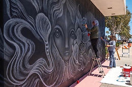 Gloria Muriel painting mural.jpg