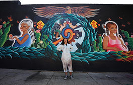 Isabel Figueroa posing with finished mur