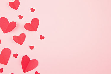 Paper hearts over the pink pastel backgr