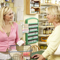 Female sales assistant in health food st