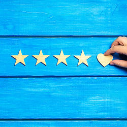 four stars and heart on a blue backgroun