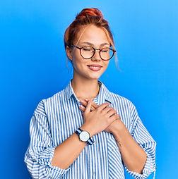 Young beautiful redhead woman wearing ca