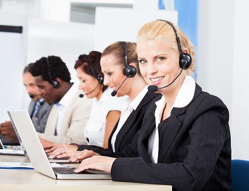 Happy Co-workers Wearing Headsets Workin