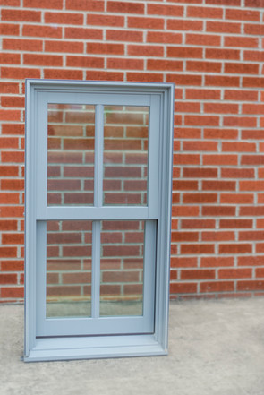 """Double Hung: Dove gray clad: Concealed jambliners: 1-1/4"""" ovalo SDL."""