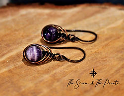 Amethyst herringbone earrings with logo.