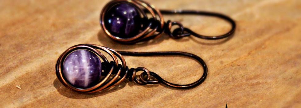 Amethyst herringbone earrings with logo.