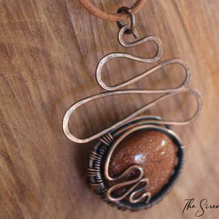 Goldstone and waves pendant