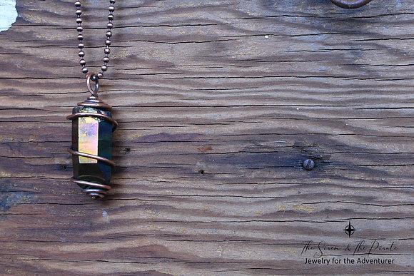 Titanium quartz pendant