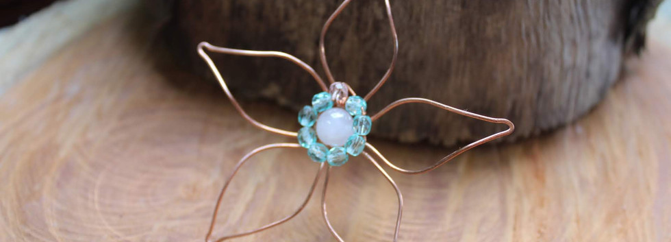 delicate flower pendant with rose quartz