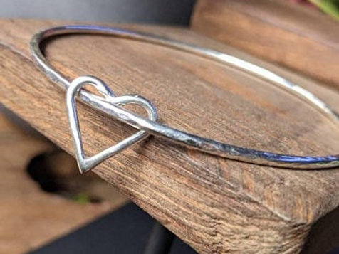 Sterling Silver Bangle with an open heart in silver