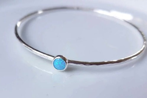 Sterling Silver Bangle with a synthetic blue opal