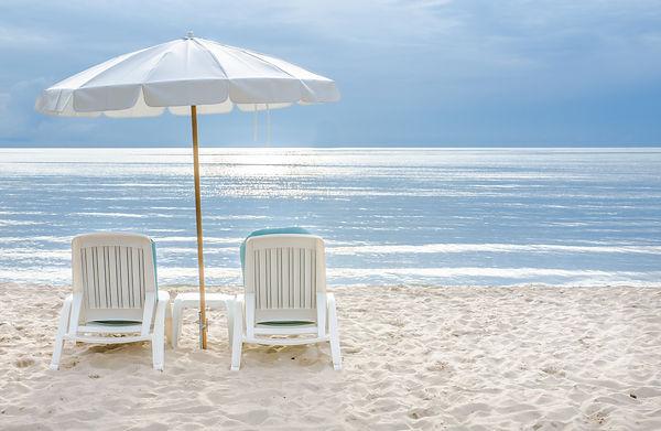 Beach chair on sand beach.jpg