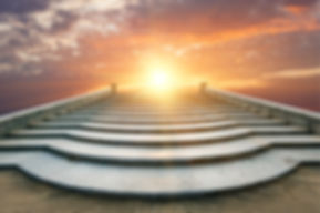 concrete-staircase-going-up-into-sunrise