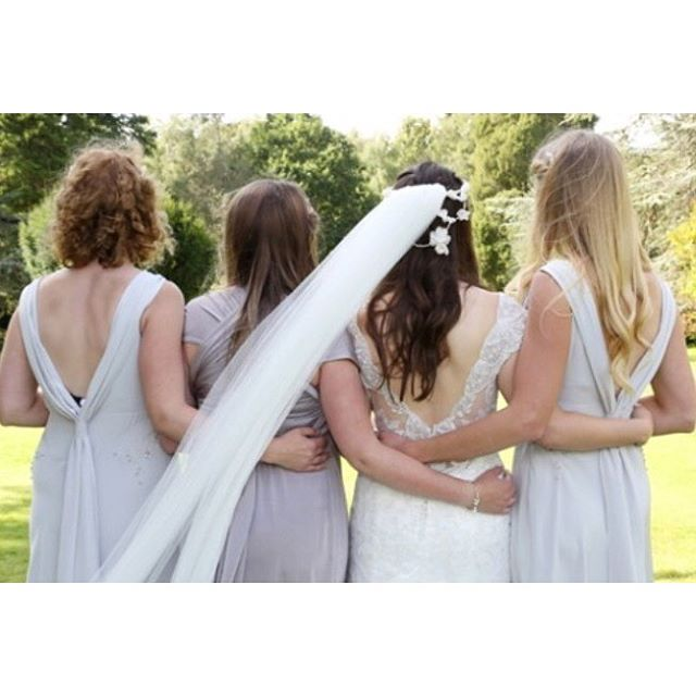 Gorgeous back shot of lovely bride Liz and her gorgeous bridesmaids. Crown by _love_from_becky photo