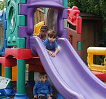 Children playing on the slide