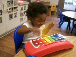 Big smiles when exploring music!