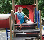 Child playing on equipment