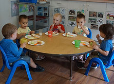 Children eating lunch together at a table