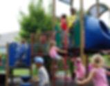 Children climbing on play equipment