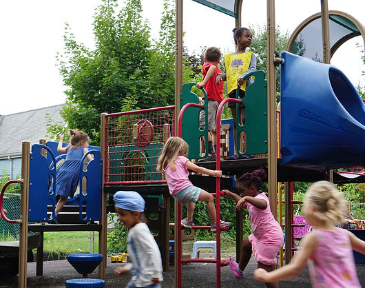 Children climbing on play equipment
