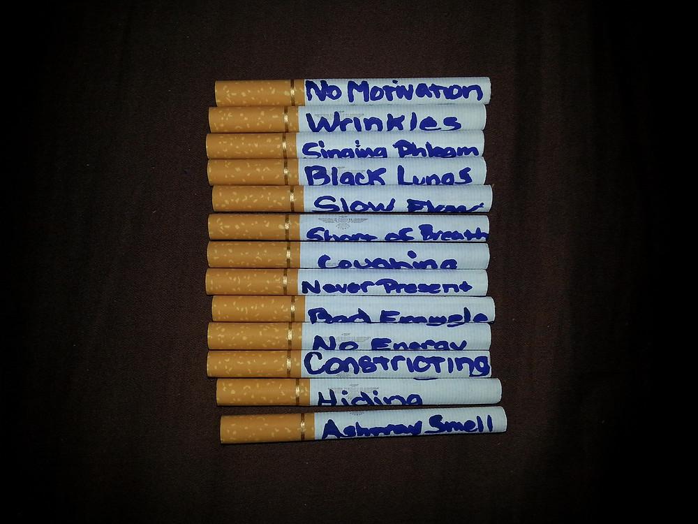 Cigarette smoking symptoms written on cigarettes.  One method to quit smoking.
