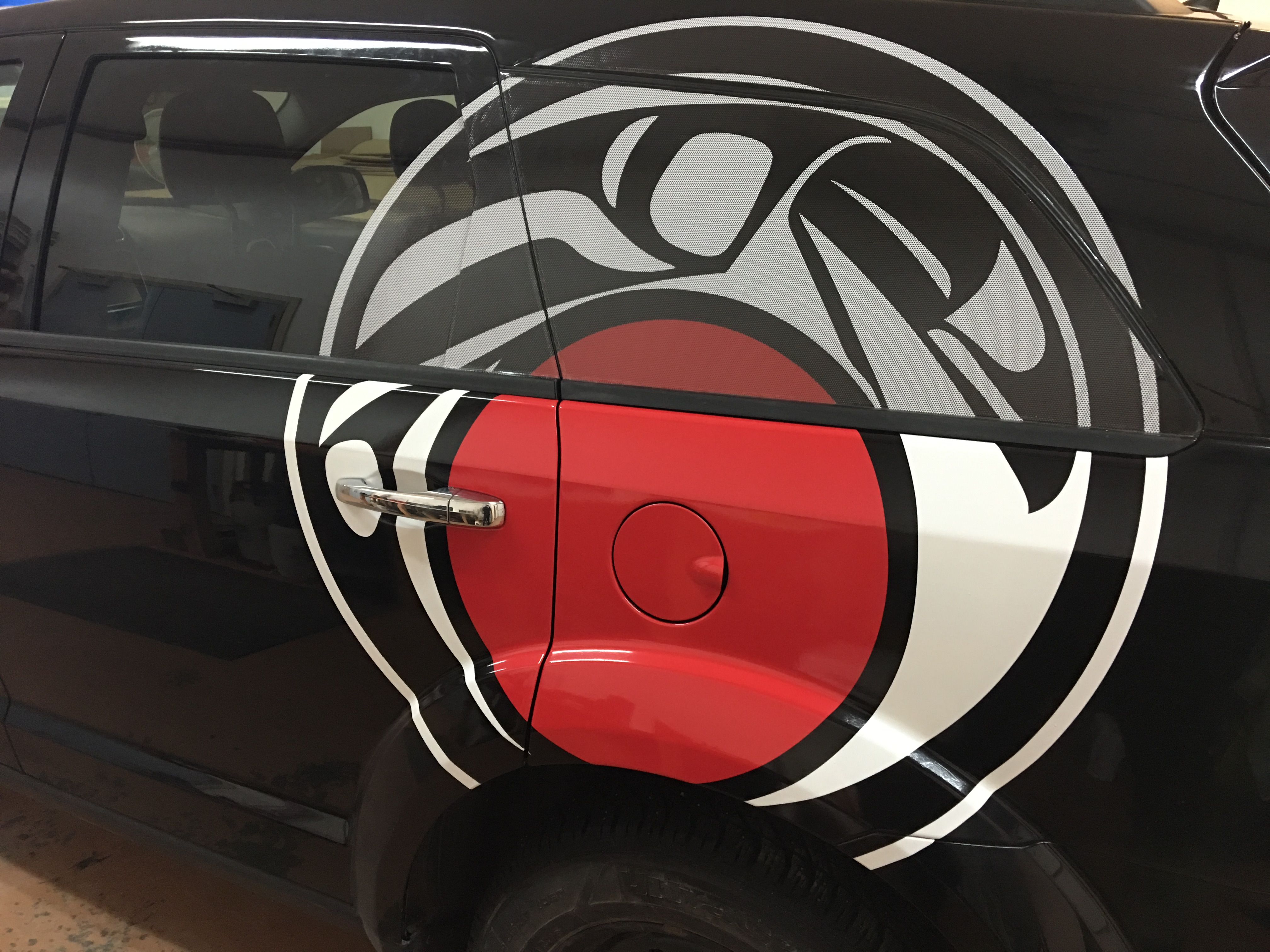 Vehicle decal with perforated window vinyl
