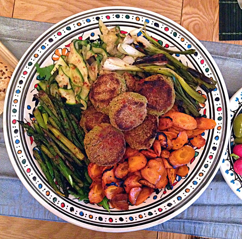 vegan and gluten-free falafel, zucchini, carrots, asparagus, spring onions