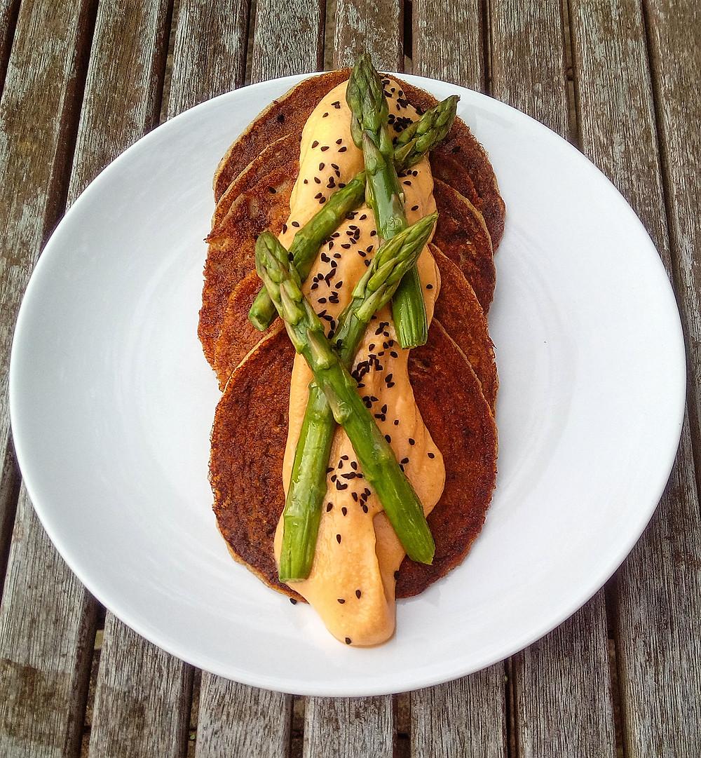 sesame and artichoke savoury pancakes with smoked cauliflower 'cheese' sauce; vegan