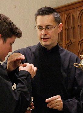 Louis Tofari teaching future MCs how to present the incense spoon to the celebrant