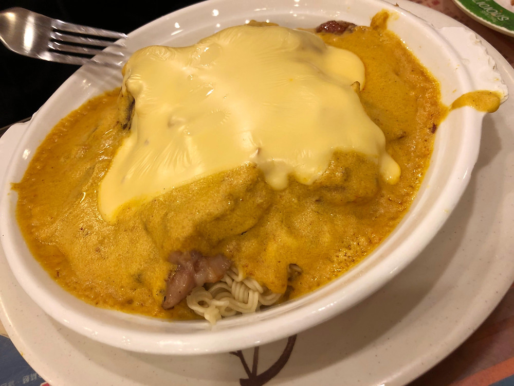 The famous curry pork chop noodles with cheese at Kah Wah Café