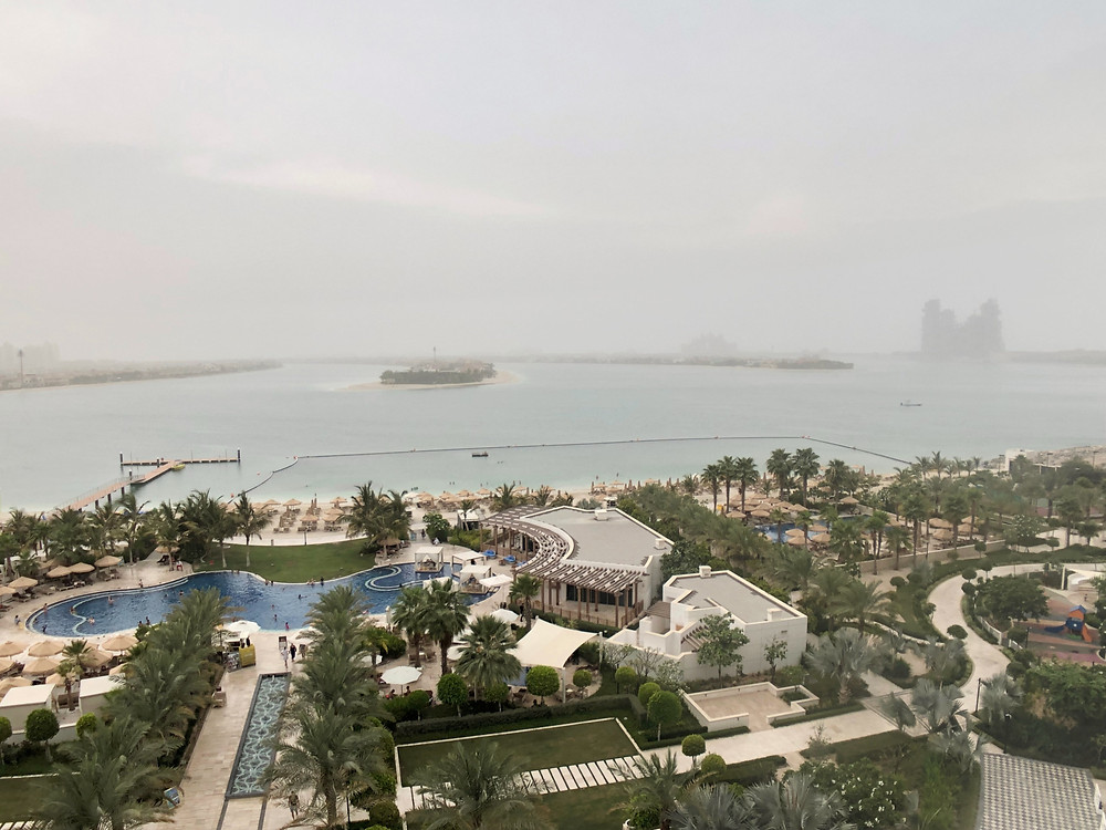 Pearl Club Lounge - View of the hotel's swimming pool and private beach