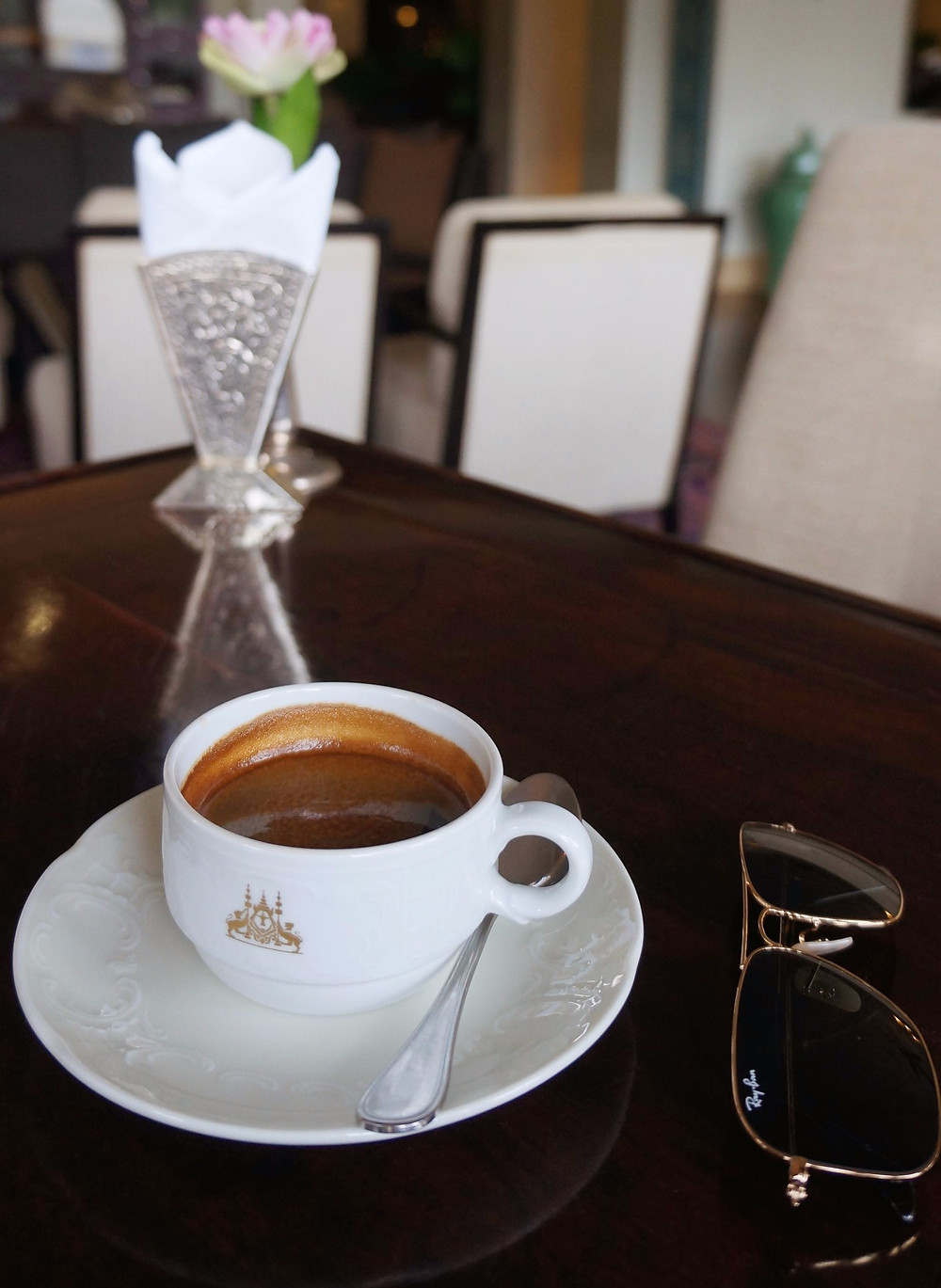 Enjoying a cup of coffee after afternoon tea at Raffles Grand Hotel D'Angkor