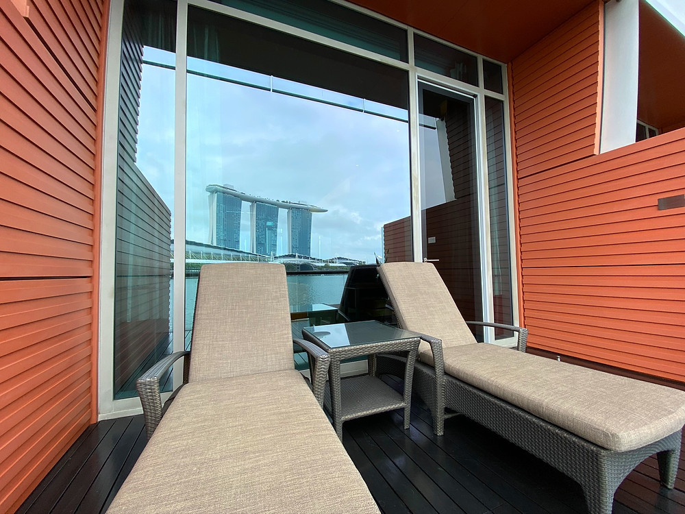 Fullerton Bay Hotel Premier Bay View Room - View of the outdoor lounge chairs