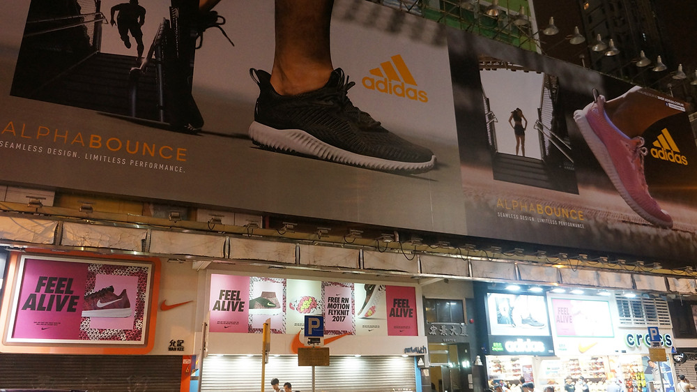 Advertisements everywhere promoting their brands at Sneakers Street
