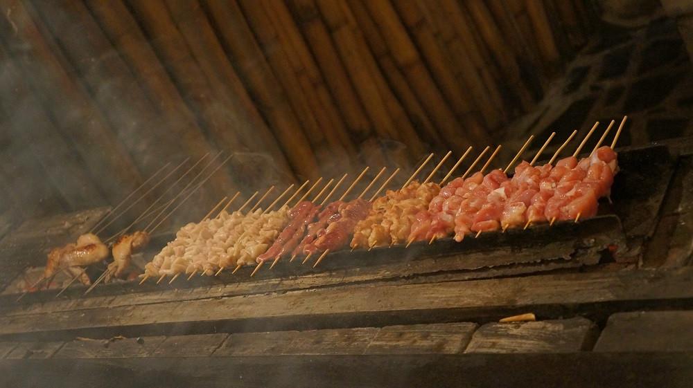 Fresh chicken meat being grilled at Nihonbashi Yakitori Garden