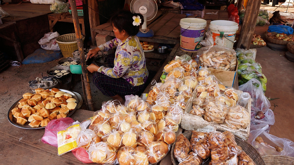 A lady mending her stall at a local market in Siem Reap