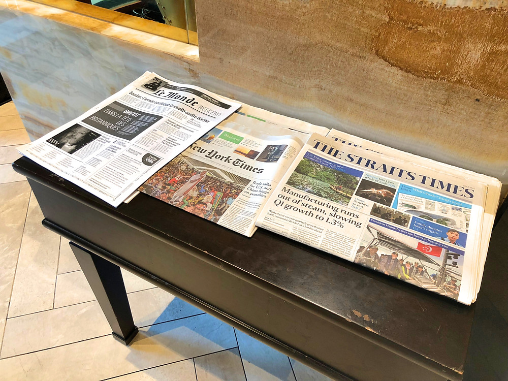 Selection of international newspapers while having breakfast.