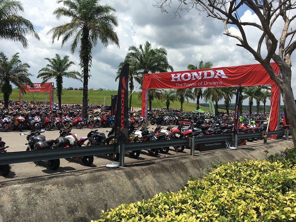 Rows of motorcycles parked around Sepang Circuit