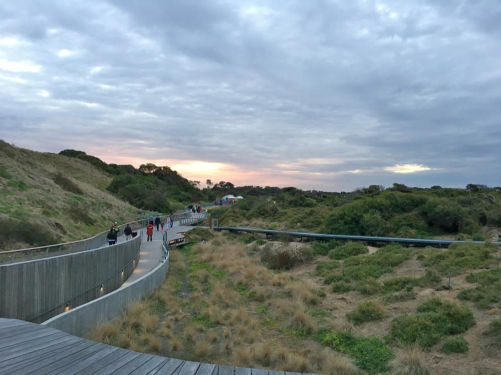 Walking towards the beach as the sun sets over Phillip Island