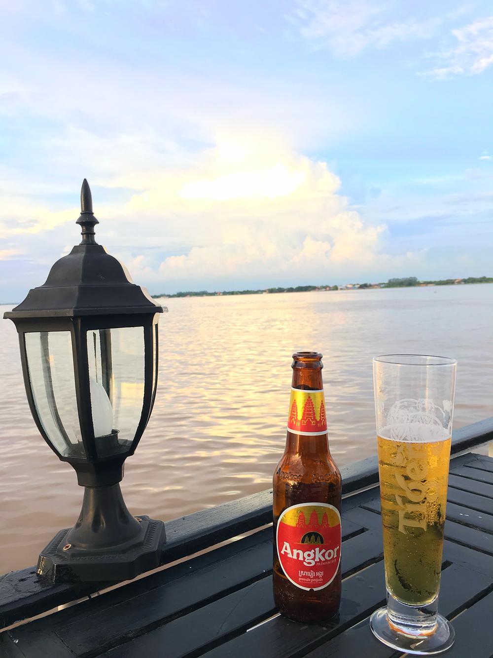 Enjoying a beverage while sailing along the Tonle Sap